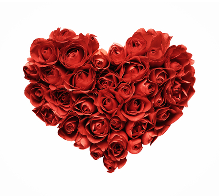 Heart shaped red roses isolated on white background