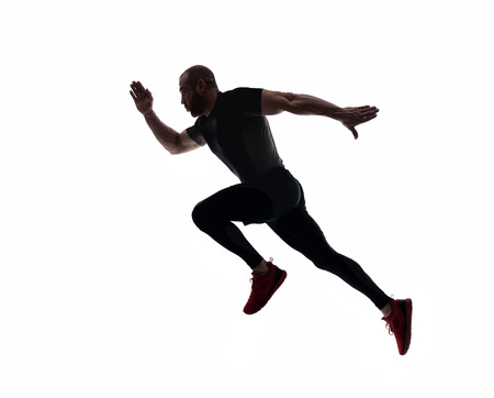 Silhouette of sports man running, isolated on white background Stockfoto
