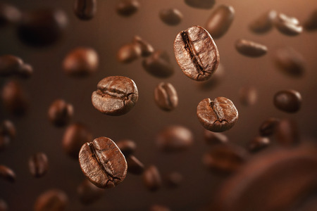 Background made of fresh coffee beans falling down with copy space Stockfoto