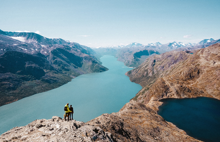 Couple enjoy the view at the norwegian landscape
