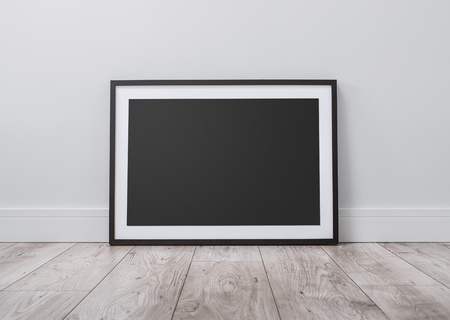 Blank picture frame on the floor with copy space clipping path for the inside