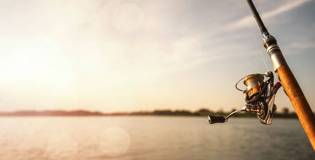 Close up of a fishing rod during the sunset with copy space Stock fotó
