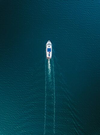 Aerial view of luxury yacht on the empty ocean with copy space Stock fotó