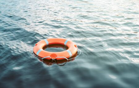 Life buoy floating on the water with copy space Stock fotó