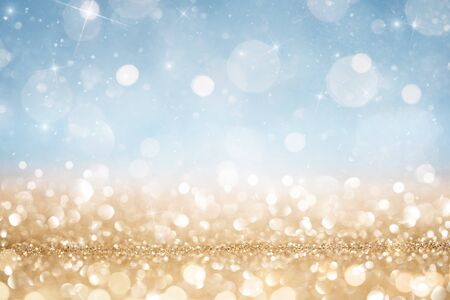 Abstract defocused gold and blue glitter background with copy space Standard-Bild