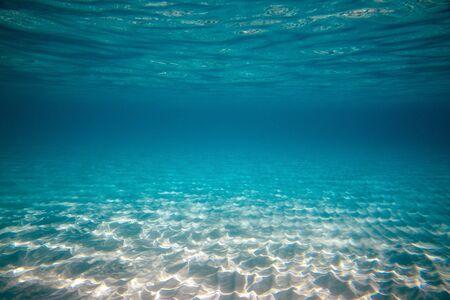 Empty underwater ocean bottom background with copy space