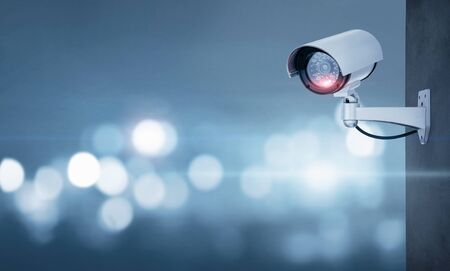 Close up of CCTV camera over defocused background with copy space Фото со стока