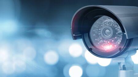 Gros plan d'une caméra de vidéosurveillance sur fond défocalisé avec espace de copie Banque d'images
