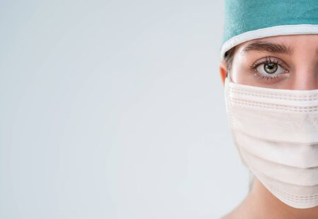 Close up of female doctor wearing face mask with copy space