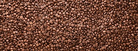 Coffee beans panoramic background, texture with copy space