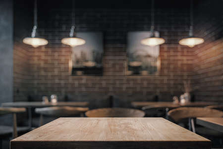 Empty coffe table at night over defocused background with copy space 版權商用圖片