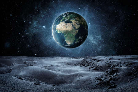 Planet earth seen fron the moon surface with copy space 版權商用圖片