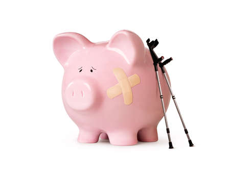 Injured piggy bank isolated on white background