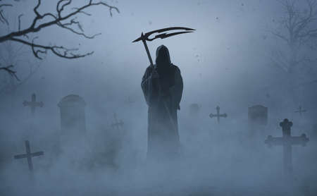 Silhouette of a grim reaper on a grave yard