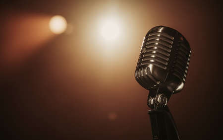 Close up of a retro microphone at the stage with copy space