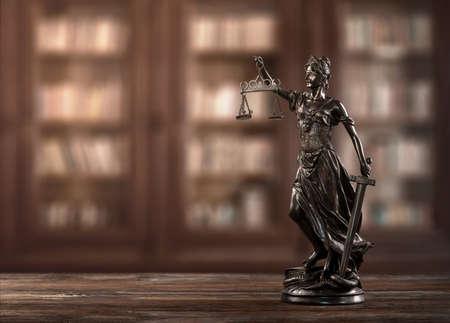 Close up of themis, justice woman figure on a desk with copy spcae Archivio Fotografico