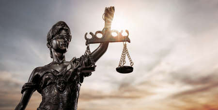 Close up of lady justice, Themis bronze figure over the sky background with copy space Archivio Fotografico