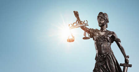Lady justice, Themis sculpture over clear blue sky with copy space Archivio Fotografico
