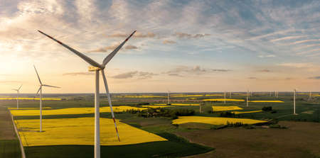 Panoramic aerial view of wind turbienes at the sunset with copy space Archivio Fotografico