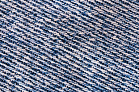 the close range: Texture of blue jeans. Shot from close range. Stock Photo