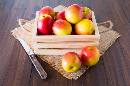 ambrosia: Apples in wooden crates placed on the wooden floor. Stock Photo