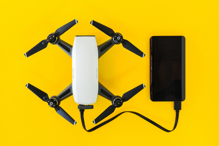 Small Drones are charging their batteries with Power Bank.