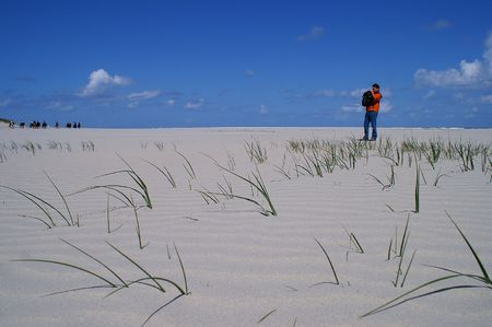 expanse: Holliday on Spiekeroog - Small figures in the endless expanse of a beach at the northsea coast