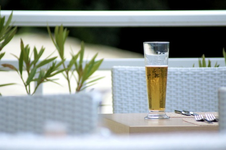 a glass of beer on a summer-terrace