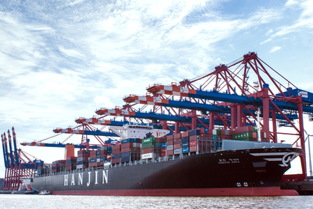 The Hanjin Asia, one of the biggest container-ships worldwide at a container-terminal in hamburgs container-port Editorial