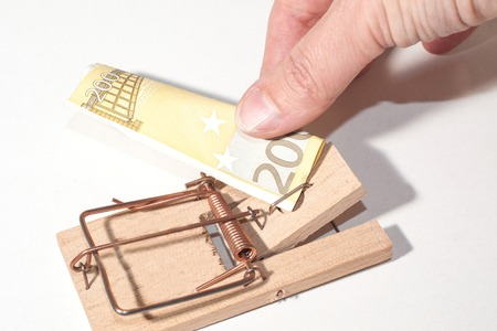 mousetrap with 200-Euro-Note and fingers pulling photo