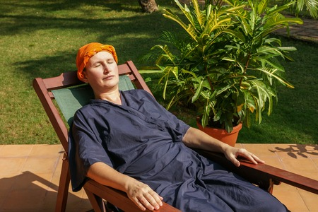 woman has a rest after an ayurveda-application, on her head a herbal pack