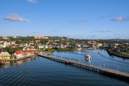 antigua: look at Antigua-harbour by sundown whilst leaving with a ship Editorial