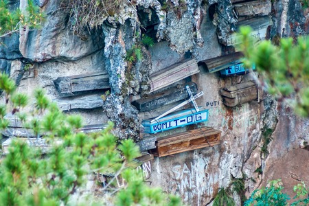 coffins: Close-up picture of a mountain-wall with some hanging coffins, Sagada, Luzon, Philippines