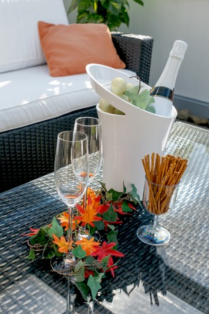 Terrace with champagne glasses and champagne bottle in cooler photo