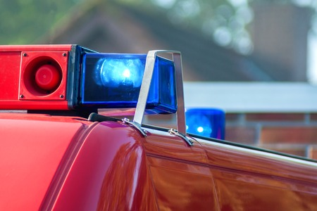 sirens: close-up picture of blue lights and sirens on a fire-truck Stock Photo