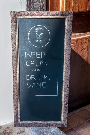 aphorism: large slate in front of a restaurant with Aphorism about wine Stock Photo