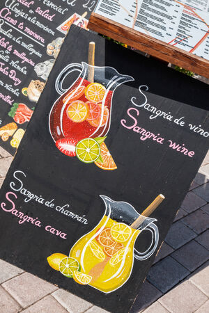 sangria: brightly painted slate in front of a restaurant with offer for sangria Stock Photo