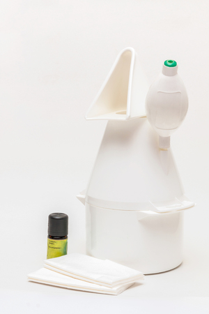 Vaporizer with eucalyptus oil and paper-handkerchiefs in front of white background