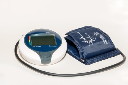 blood pressure unit: Household blood pressure monitor isolated against a white background