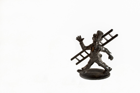 black chimney sweep figure with ladder  for good luck, isolated photo
