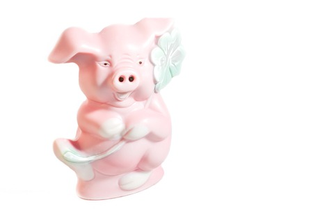 pink pig figure with clover for good luck, isolated photo