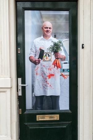 Poster at a Dutch front door: the vegetarian butcher