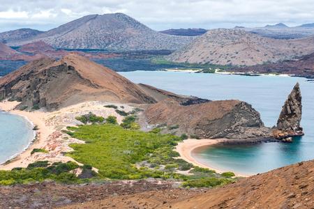 bartolome: volcano island St. Bartolome, Galapagos, Ecuador with Pinnacle-Rock Stock Photo