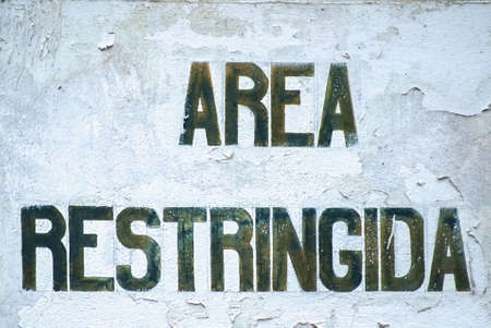 attentiveness: old sign with the Spanish statement protected area Stock Photo