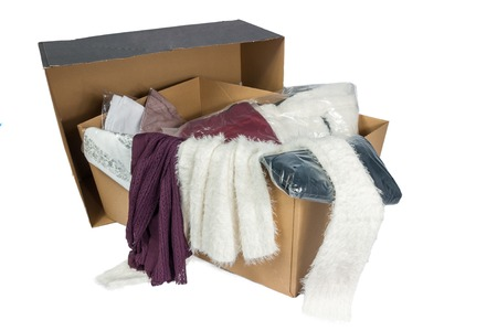 unpacked: Cardboard with various packed and unpacked clothes, isolated