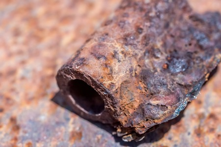 rusting: Part of a rusted hinge on old rusting tin