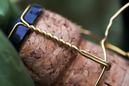 atmospheric pressure: Close up of a champagne cork with green cloth