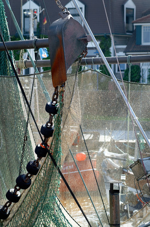 Fishing nets in the harbor on fishing boat photo