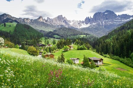 rosengarten: View of the village Tiers and the Rosengarten mountains in the Dolomites, South Tyrol Stock Photo