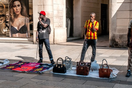 illegality: Illegal street vendors with brand copies in Barcelona Editorial